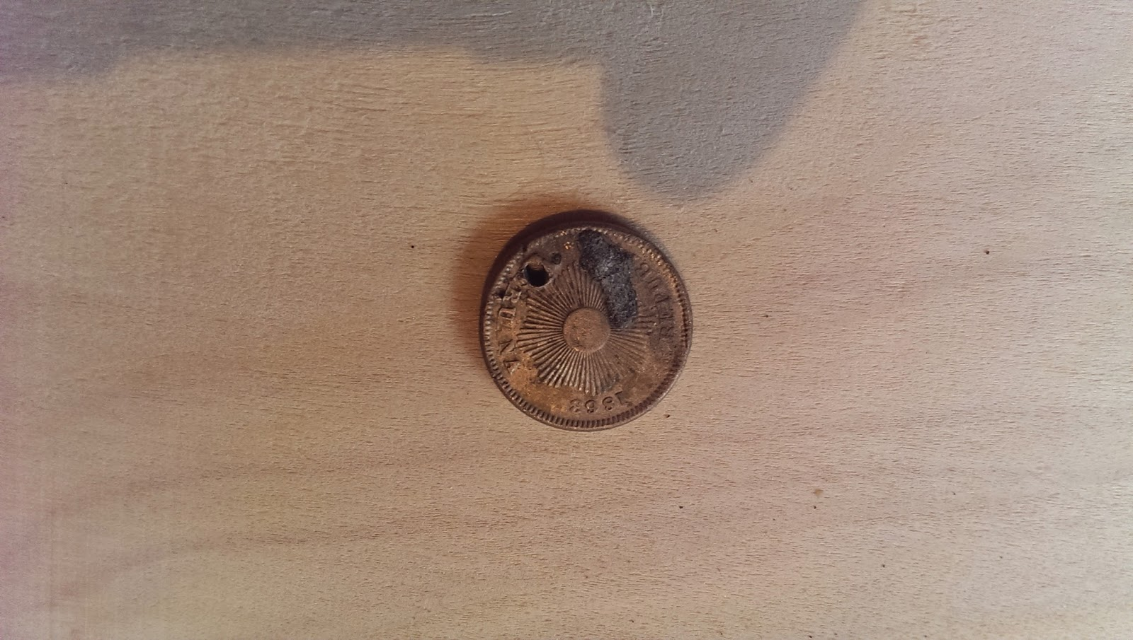 A picture of an unknown coin that was found whilst metal detecting