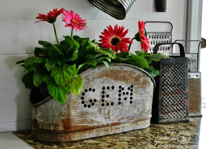 Spring Flowers Gerbera Daisies in Repurposed Metal Salvage by http://knickoftimeinteriors.blogspot.com/