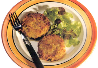 Curried vegetable burgers: potato-based vegetable patties flavoured with curry powder and fried until golden served with a salad