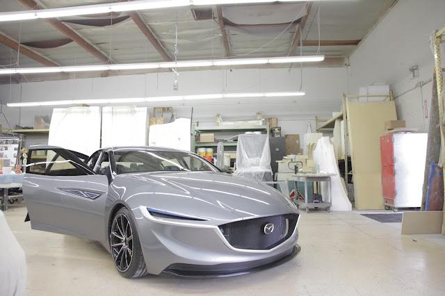 Front 3/4 view of Mazda Deep Orange 3