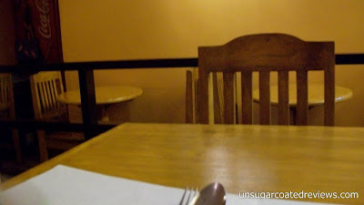 wooden chairs and tables furniture at The Lazy Bean
