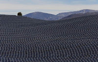Solar panels produce renewable energy at the photovoltaic park in Les Mees, in the department of Alpes-de-Haute-Provence, southern France, March 31, 2015. (Credit: Reuters/Jean-Paul Pelissier) Click to Enlarge.