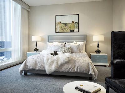 elegant bedroom in muted color palette and calming painting