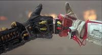 Robot Jox crash and burn fist bump