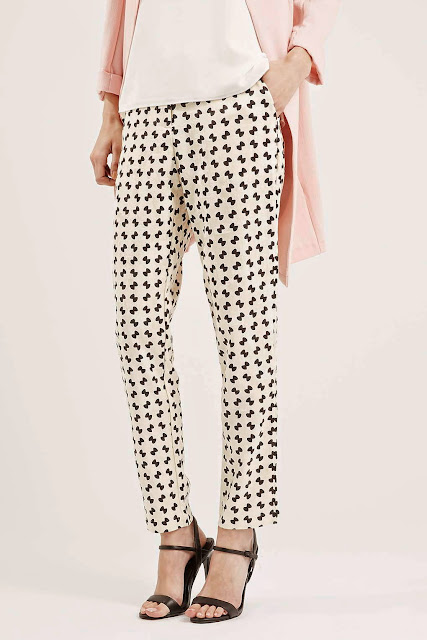 black print on white trousers