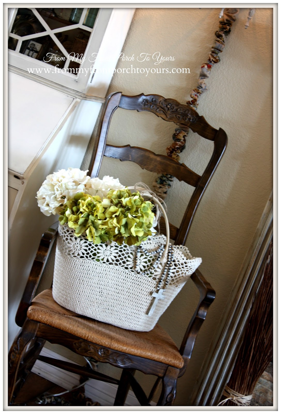 Crocheted tote from HomeGoods with wooden rosary beads create a French Farmhouse mood over at From My Front Porch To Yours.