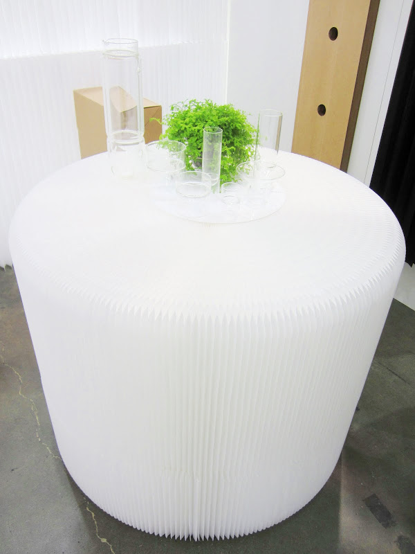 Two Softseating White Textile Fanning Stools stacked on top of each other to make a table