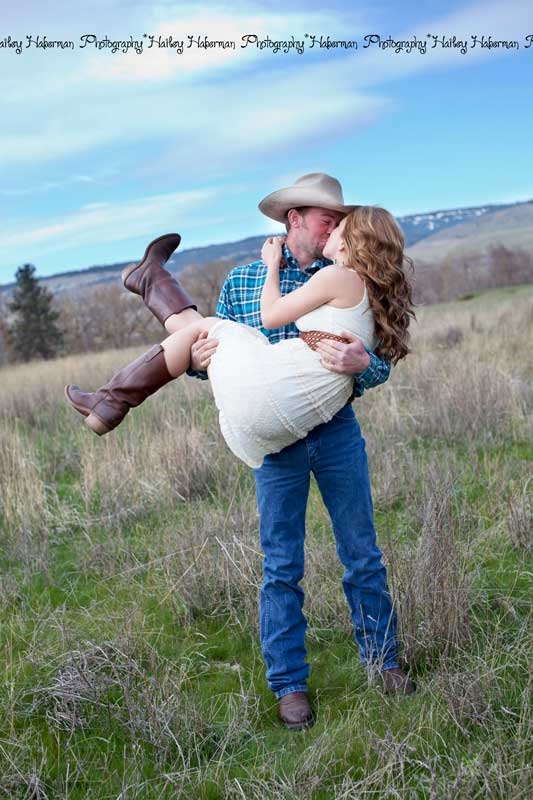 cowboy holding his future bride, cowboy engagement session with Levi & Cara by Ellensburg Wedding Photographer Hailey Haberman
