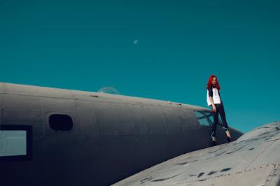woman standing on plane, fashion shoot on airplane, airport, fashion photographer nyc