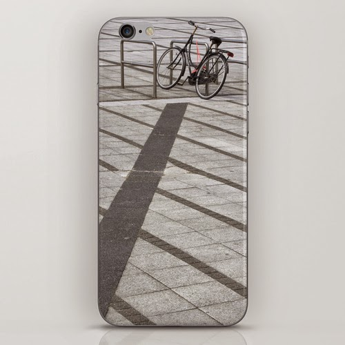 iPhone skin: bicycle on patterned pavement