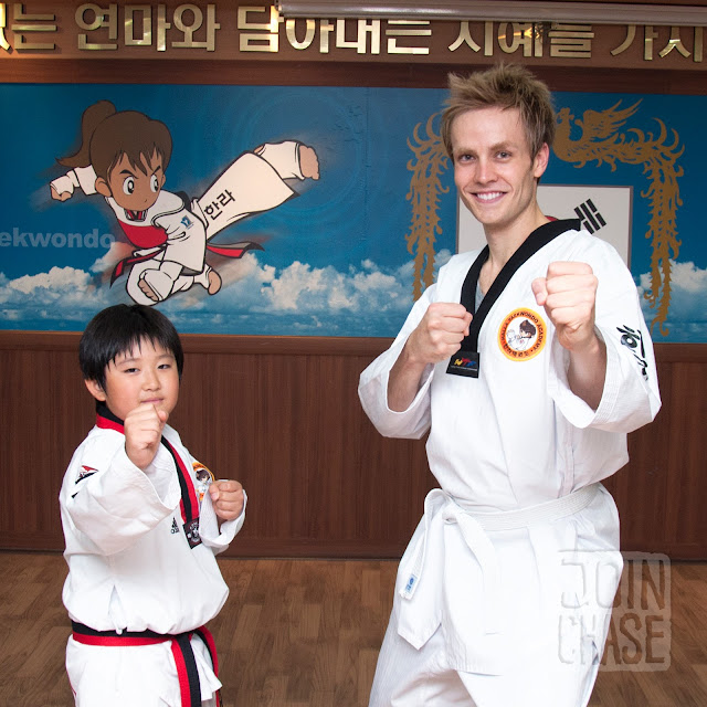 A Guest English Teacher learning Taekwondo with an elementary student in South Korea.