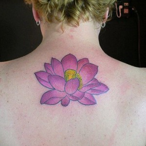 Lotus Flower Tattoo Design on Girls Upper Back