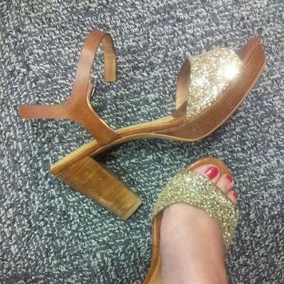 Gold glitter high heel shoes