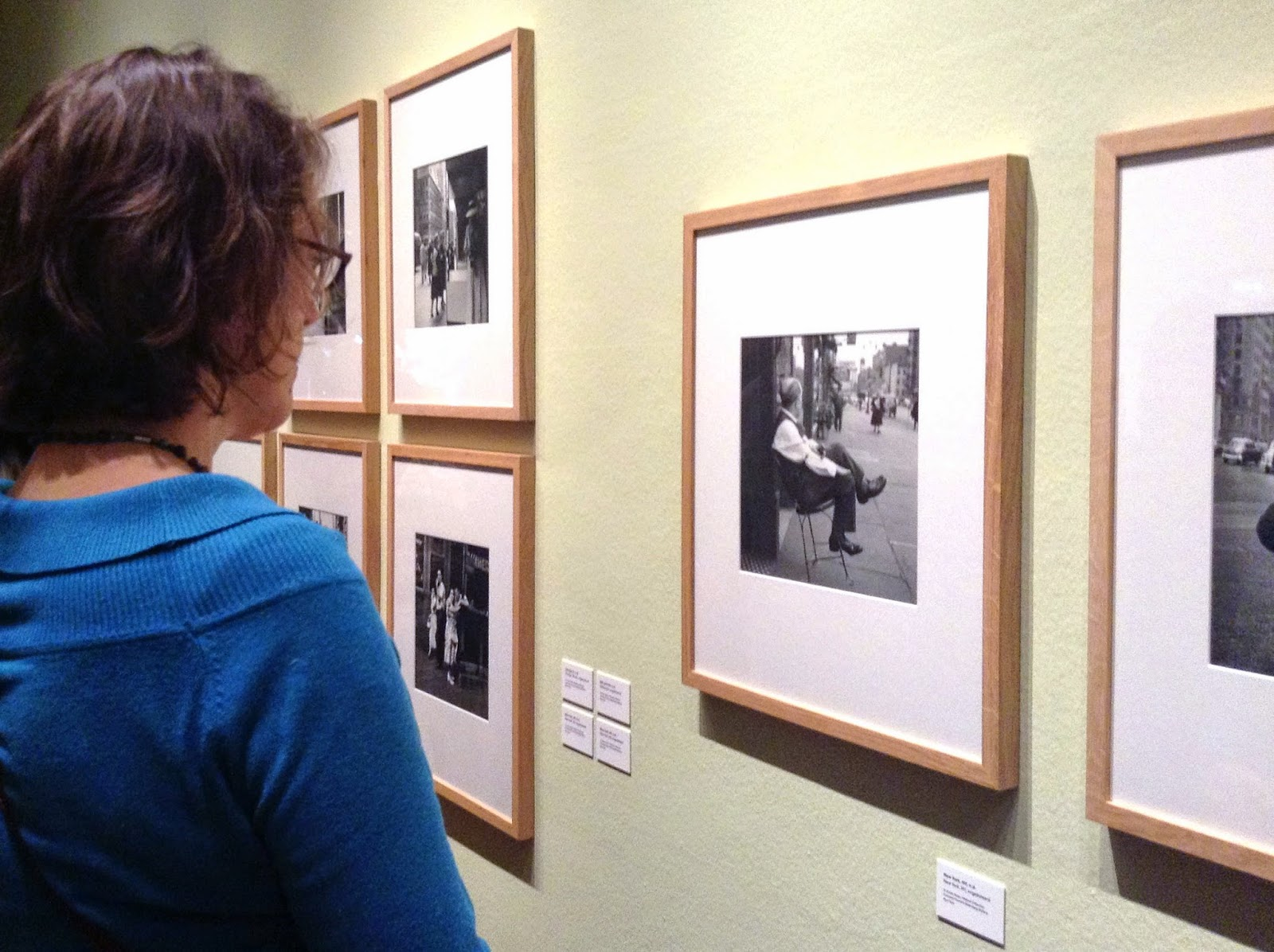 my friend C. looking at Vivian Maier's photos