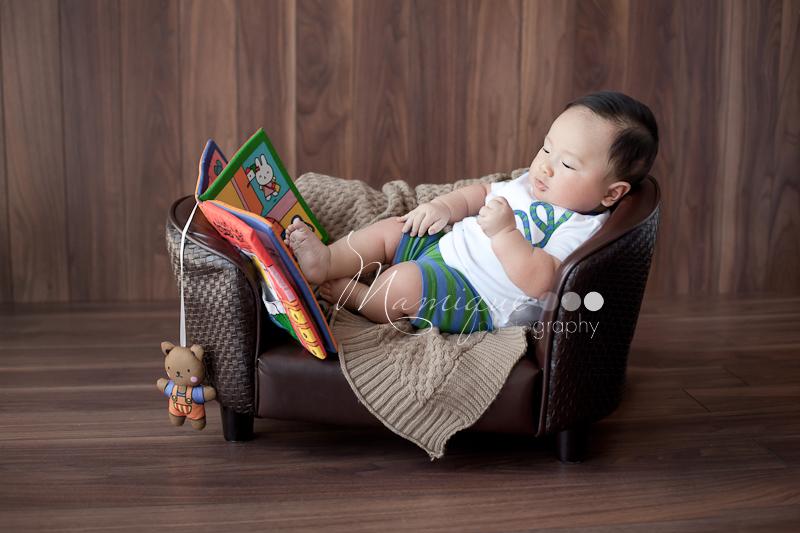 Cute boy reading on a couch Richmond BC