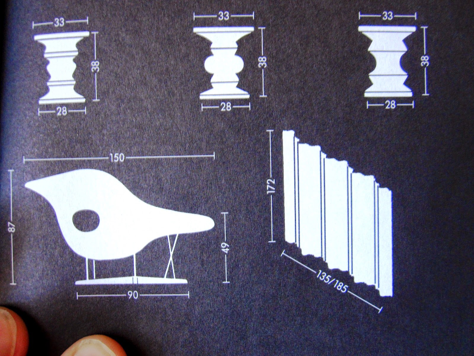 Close up of a page in a vitra catalogue, showing measurements for Eames stools.