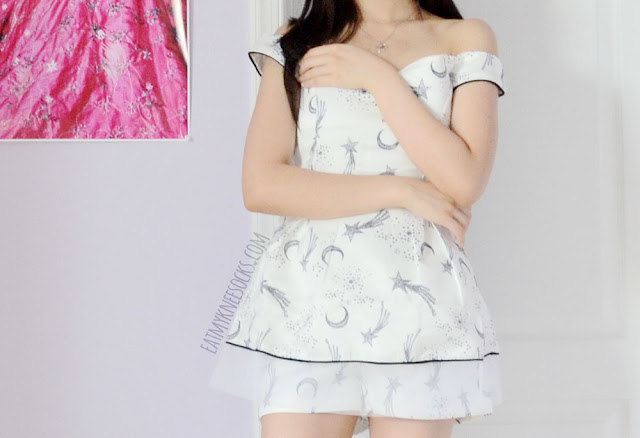 More photos of the white moon-and-stars boat neck top and shorts co-ord set from SheIn, a dupe of the La Boutique design.