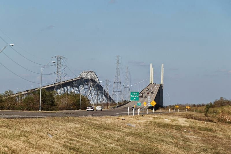 The Rainbow Bridge is a cantilever bridge stand on Neches River in Southeast Texas just upstream from Sabine Lake. It allows State Highway 87 and State Highway 73 to connect Port Arthur in Jefferson County on the southwest bank of the river with Bridge City in Orange County on the northeast bank.