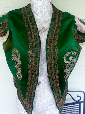 green antique theatrical vest