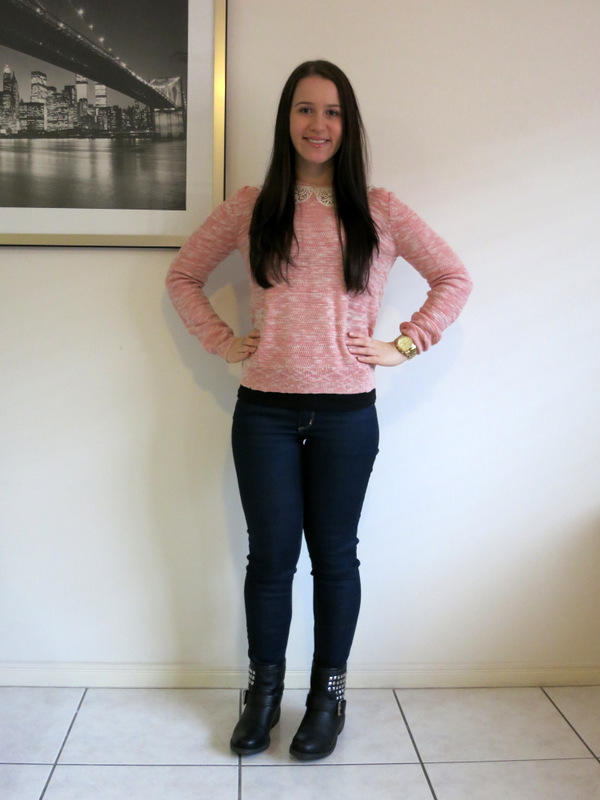 Dark wash denim jeans, pink knit, embellished boots with gold and silver jewellery.