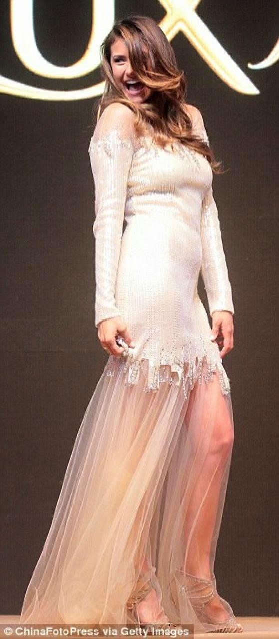 Nina Dobrev promotes Lux shampoo in Beijing