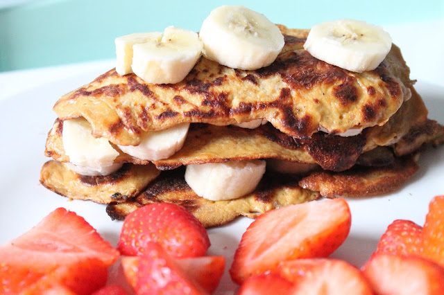 recipe for slimming world syn free pancakes salted caramel flavour stacked up with bananas in between and strawberries on the side