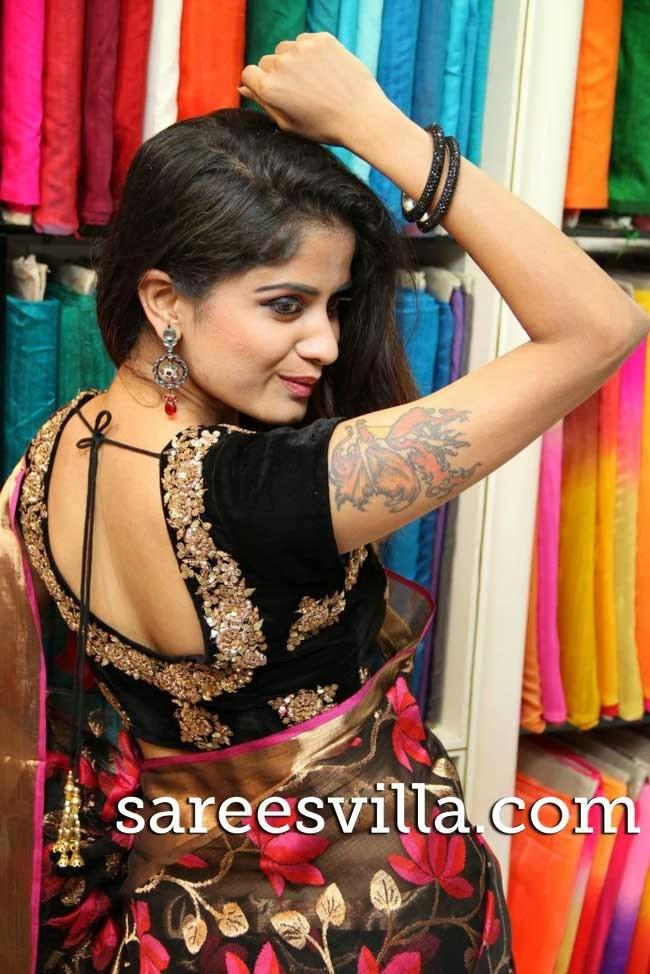 Model in black velvet work blouse