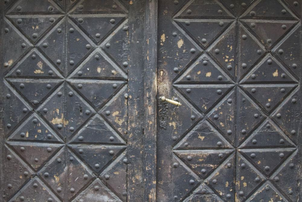 dark wooden door with rectangles and triangles
