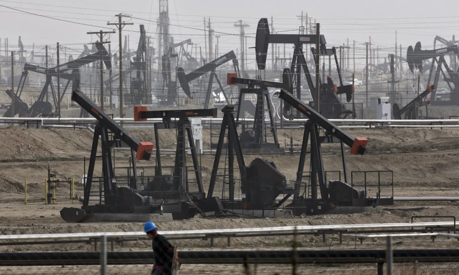 This Jan. 16, 2015, file photo shows pumpjacks operating at the Kern River Oil Field in Bakersfield, California. (Credit: Jae C. Hong/AP) Click to Enlarge.