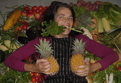Image of Sue Visser with produce and pineapples on her chest (provided by Yindee on InfoBarrel)