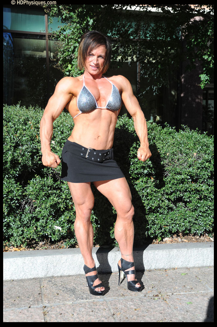 Christine Sabo Modeling Her Muscular Body In A Tiny Skirt And Heels