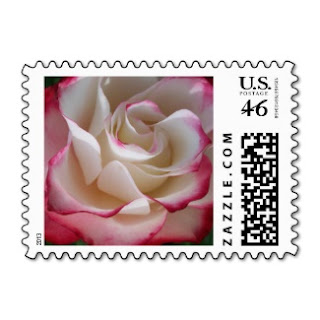 US postage stamp with a white rose with red tips