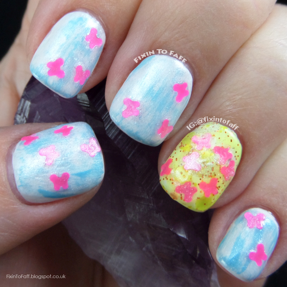 Sunshine, happiness, and butterfly distressed nail art.