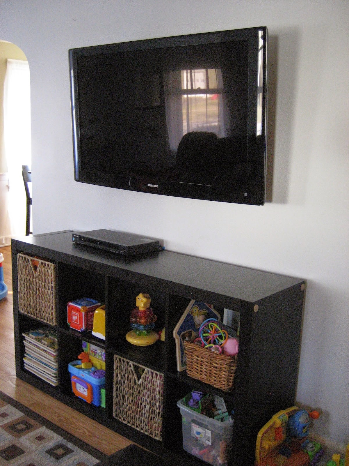 how to hide cords behind tv