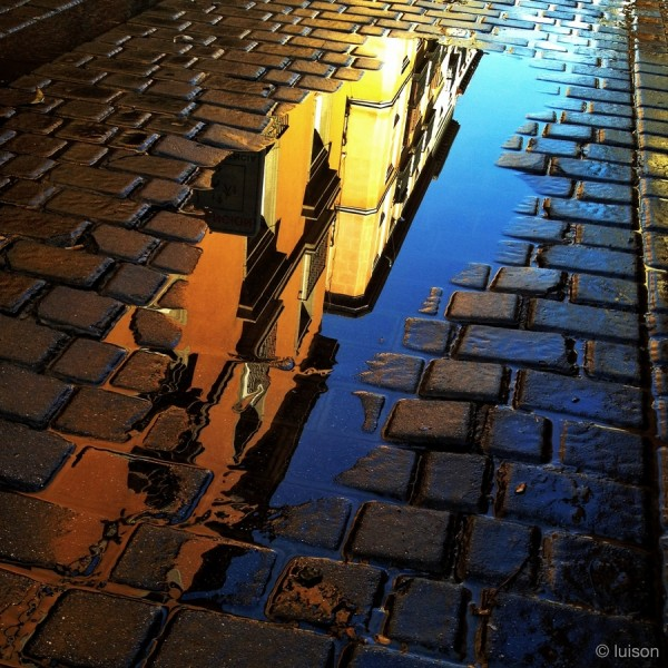 Madrid reflected on a puddle