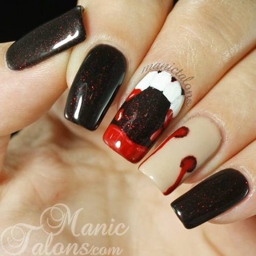 Halloween manicure with vampire fangs and bite marks