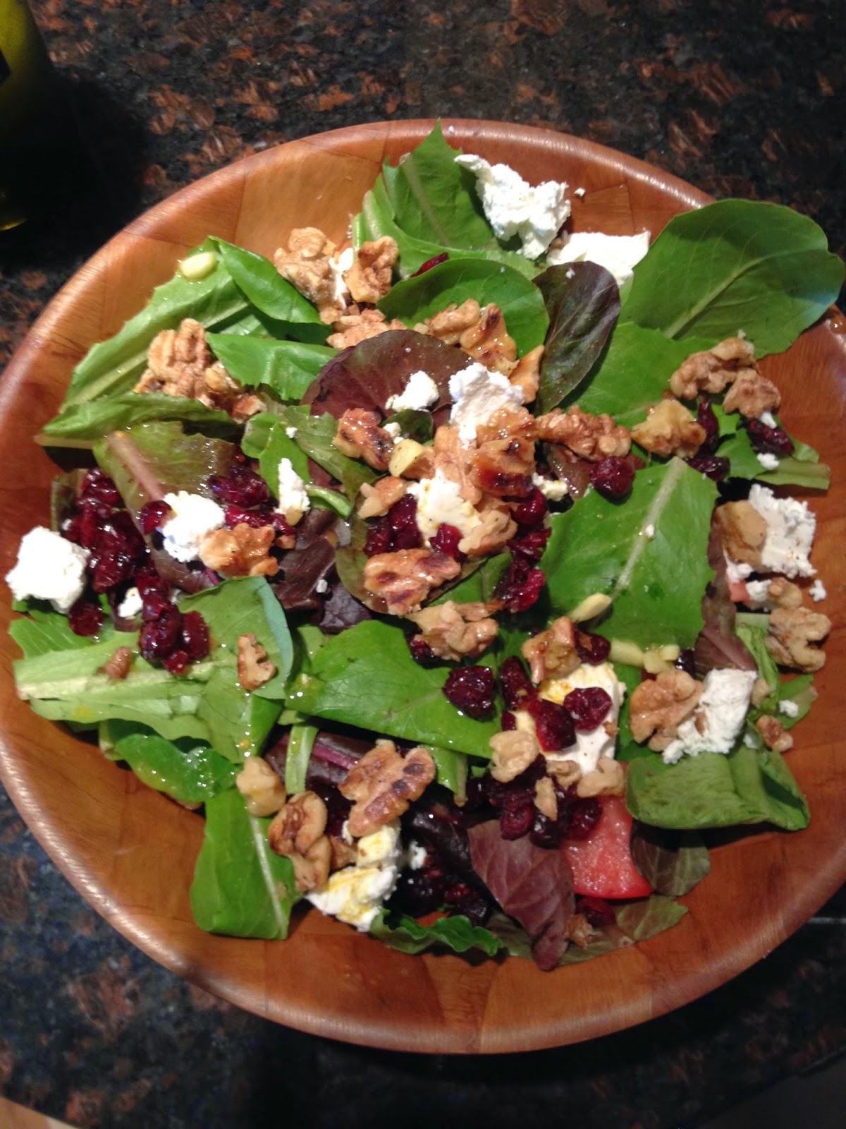 Spinach salad with cranberries, walnuts & goat cheese