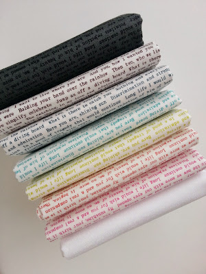 Rainbow stack of Sunprint Text Prints from designer Allison Glass