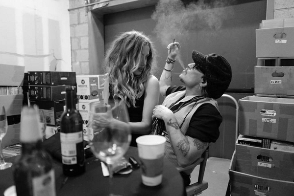 Amber Heard and Johnny Depp smoking