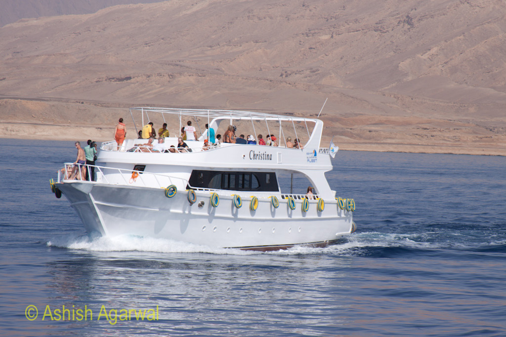 Tourists relaxing on the deck of a yacht in the Red Sea off Sharm el Sheikh in Egypt
