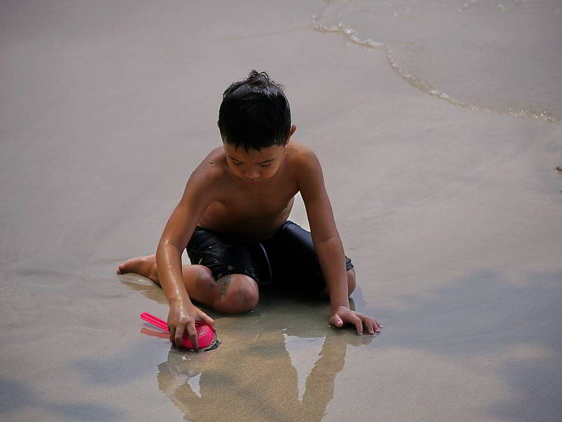Child playing on White Sands Beach, Koh Chang