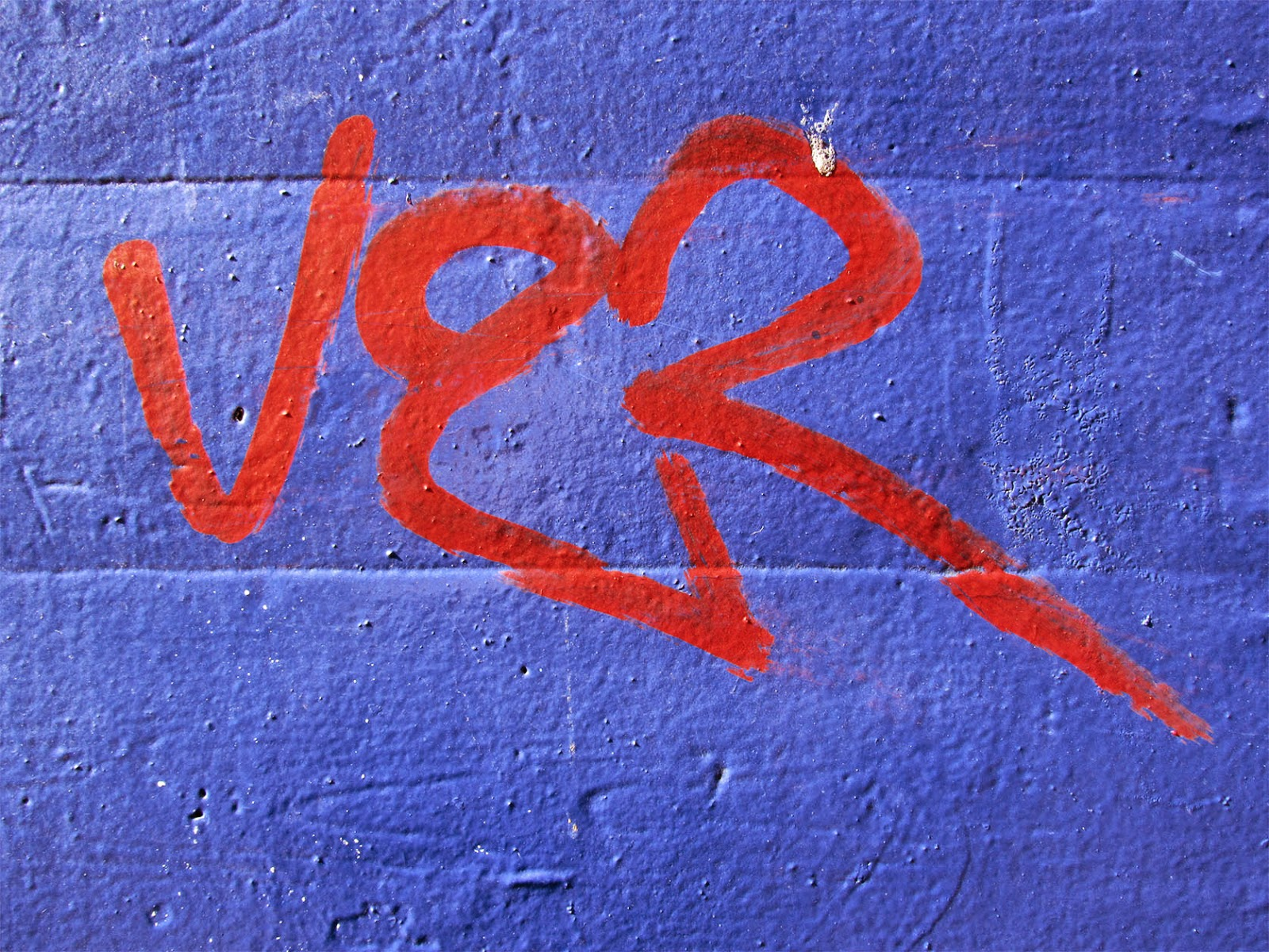 red graffiti on purple blue wall