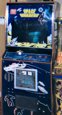 A Japanese Space Invaders arcade cabinet (though the game itself is a 1980 bootleg called Super Earth Invasion) at an amusement arcade in Lyme Regis, Devon. Although there for many years, it was removed at some point between 2007 and 2008. Image taken with disposable camera. by Billy Hicks