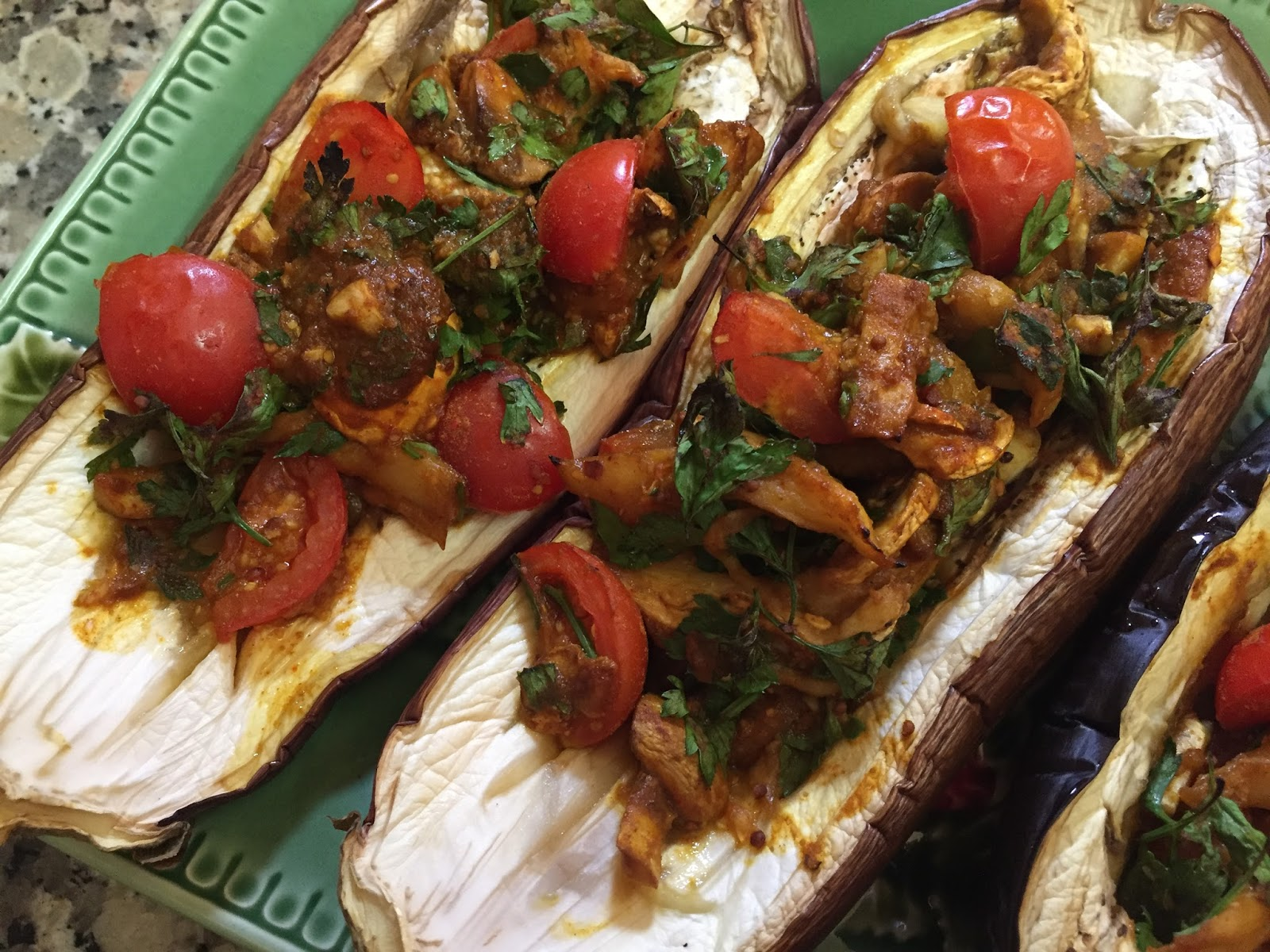 Stuffed baked eggplant aubergine clean eating vegan starter recipe here we have a lovely balance of sweet tomatoes fresh parsley garlic anda a sweet sauce of course you can get creative with the filling ideas forumfinder Gallery