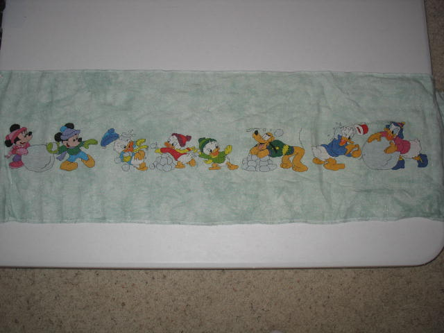 reading and stitching  disney table runner finish