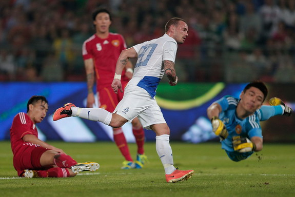 Netherlands player Wesley Sneijder reacts after scoring a goal against China