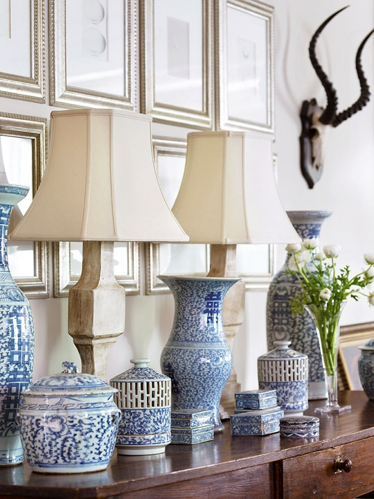 adore this gorgeous collection of blue and white jars and boxes on this console trad home