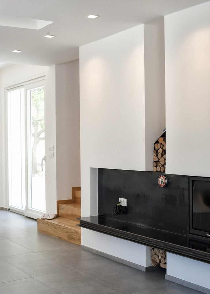 Fireplace in Modern villa Di Gioia by Pedone Working