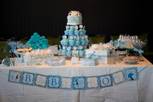 blue baby boy parisian baby shower dessert table with blue