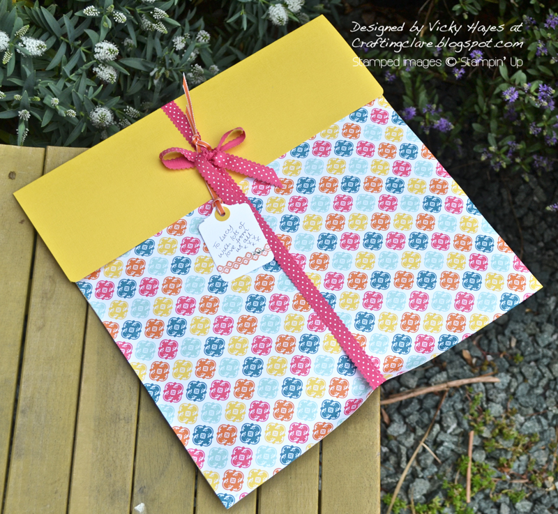 Gift wrap made with Quatrefancy designer paper from Stampin' Up